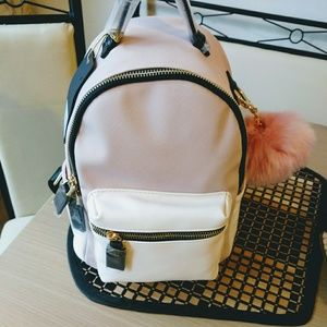 Pink Backpack with pom-pom